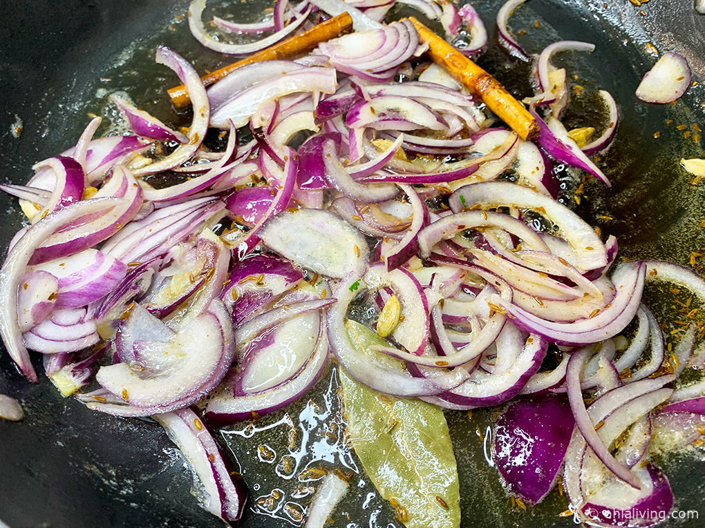 Fry biryani spices with onions